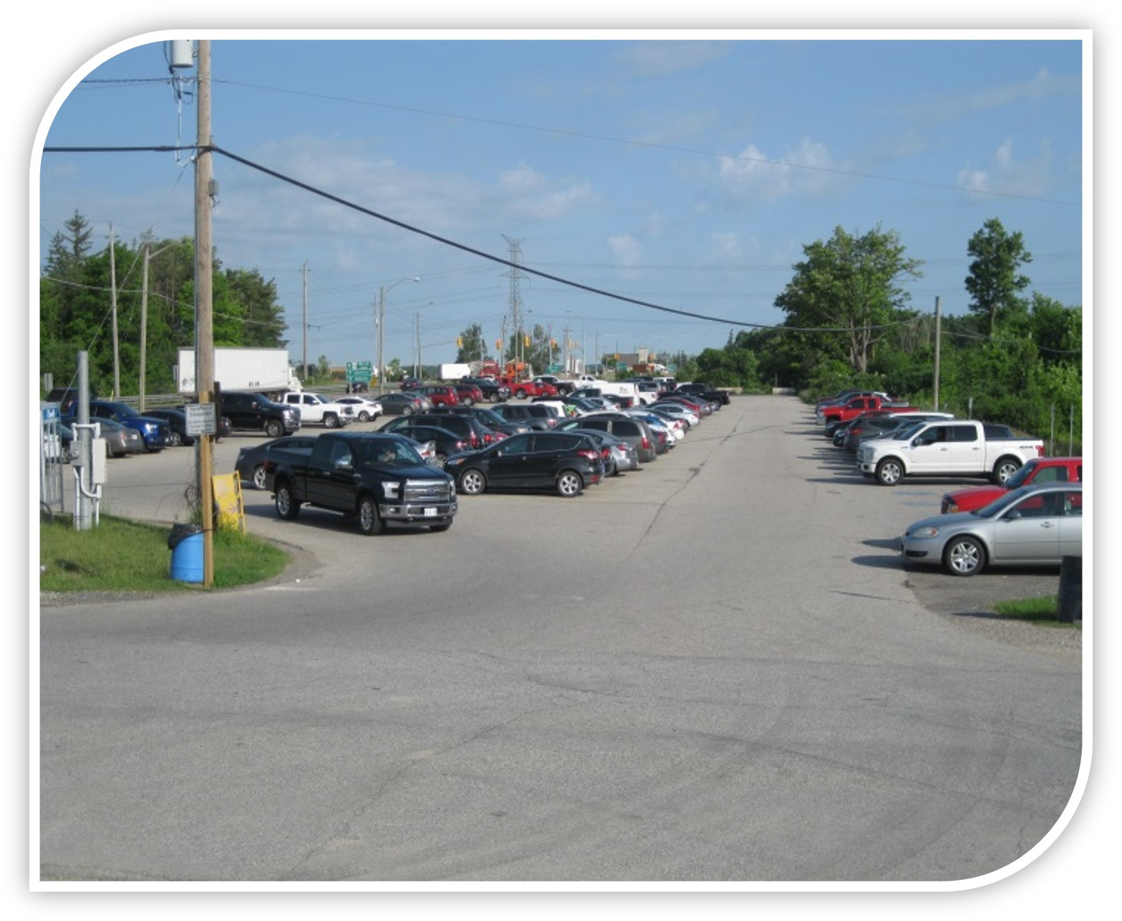 Photos of existing carpool lot on east side of Highway 6 Queen Street, south of Highway 401 in Morriston.